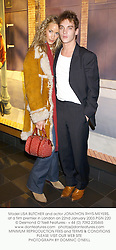 Model LISA BUTCHER and actor JONATHON RHYS-MEYERS, at a film premier in London on 22nd January 2003.	PGN 220