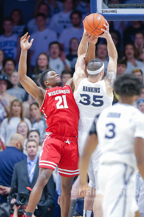 CINCINNATI, OH - NOVEMBER 13: Khalil Iverson #21 of the Wisconsin Badgers defends as Zach Hankins #35 of the Xavier Musketeers grabs the rebound at Cintas Center on November 13, 2018 in Cincinnati, Ohio. (Photo by Michael Hickey/Getty Images) *** Local Caption *** Khalil Iverson; Zach Hankins