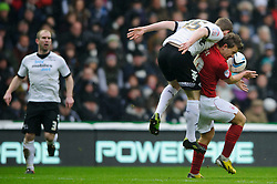 Derby Defender Mark O'Brien (IRL) an Nottingham Forest Forward Simon Cox (IRL) collide as they compete in the air during the first half of the match - Photo mandatory by-line: Rogan Thomson/JMP - Tel: Mobile: 07966 386802 19/01/2013 - SPORT - FOOTBALL - Pride Park - Derby. Derby County v Nottingham Forest - npower Championship. The meeting of these two local sides is known as the East Midlands Derby with the winner claiming the Brian Clough Trophy.