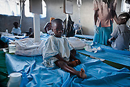 Gerard Nerulus, 6 years old recovering from cholera in a clinic run by American missionaries.The Real Hope for Haiti Cholera Clinic in Cazel is 11 kilometers off the main road passing through Cabaret, north of Port-au-Prince is run by missionaries.