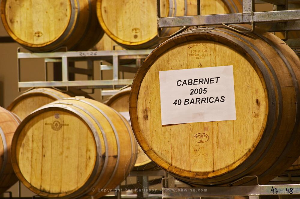 Stacks of oak barrels. Cabernet 2005 40 barriques Bodega Del Anelo Winery, also called Finca Roja, Anelo Region, Neuquen, Patagonia, Argentina, South America