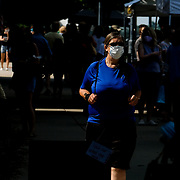 Maumee resident Carol, who declined to give her last name, wears a mask while in downtown Perrysburg, Ohio, on Thursday, July 9, 2020. Wood County was among the Ohio counties designated as Level 3 public emergency with coronavirus infections accelerating, which will bring a mask order to the county at 6 p.m on Friday. THE BLADE/KURT STEISS