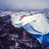 A snowstorm engulfs a trekkers camp below Thorang La pass on the around Annapurna trek