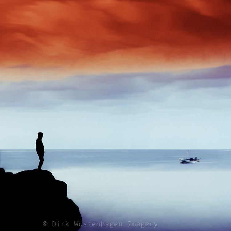 Man on a cliff looking into the distance - manipulated photograph