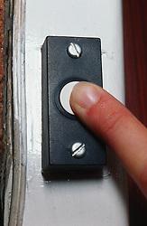 Finger pressing doorbell,