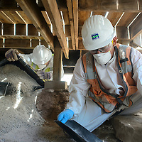 062714       Cayla Nimmo<br /> <br /> Environmental Restoration employees Luis Padilla (right) and Jose Padilla, left, add new sediment under a house in Bluewater Friday morning, after it had been cleared of uranium the previous day.