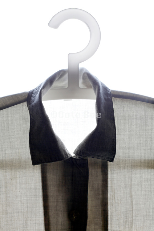 front view of button down shirt on a coathanger