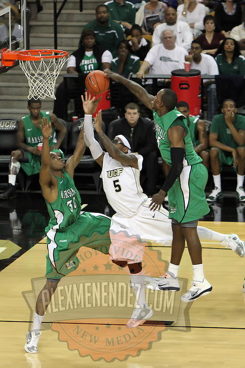 Central Florida guard Marcus Jordan (5) defends against Marshall forward Tirrell Baines (30) during a Conference USA NCAA basketball game between the Marshall Thundering Herd and the Central Florida Knights at the UCF Arena on January 5, 2011 in Orlando, Florida. Central Florida won the game 65-58 and extended their record to 14-0.  (AP Photo/Alex Menendez)