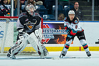 KELOWNA, BC - JANUARY 26: Trevor Wong #8 of the Kelowna Rockets looks for the pass at the net of David Tendeck #30 of the Vancouver Giants at Prospera Place on January 26, 2020 in Kelowna, Canada. Tendeck was selected in the 2018 NHL entry draft by the Arizona Coyotes. (Photo by Marissa Baecker/Shoot the Breeze)