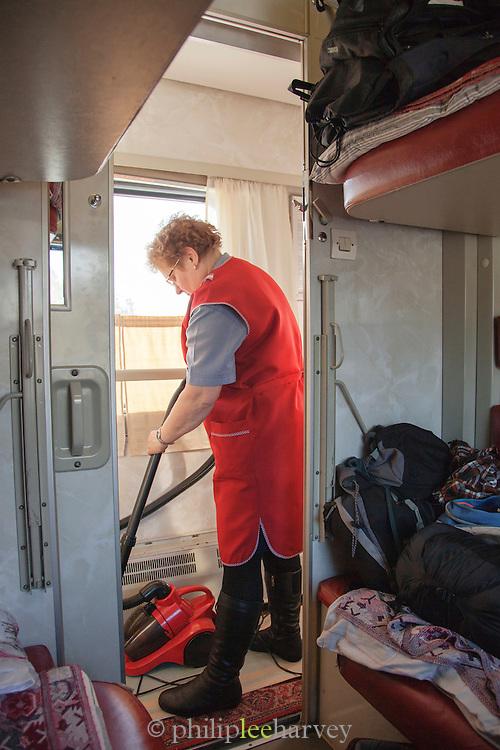 Cabin maid cleaning on-board the BAM (Baikal-Amur Mainline) Railway Line. Siberia, Russia
