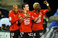 FOOTBALL - FRENCH CHAMPIONSHIP 2010/2011 - L1 - STADE RENNAIS v TOULOUSE FC - 3/10/2010 - PHOTO PASCAL ALLEE / DPPI - JOY ROMAIN DANZE (RENNES) AFTER HIS GOAL, HE IS CONGRATULATED BY STEPHANE DALMAT (L) AND GEORGES MANDJECK (R)