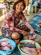 A Thai lady prepared red snapper for her family in Thailand. Editorial