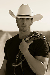 portrait of a hot All American cowboy outdoors