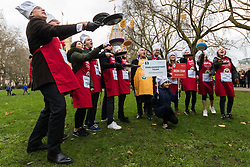 MPs and members of the House of Lords compete in the annual Rehab pancake race, a relay of eleven laps in Victoria Tower Gardens adjacent to the Houses of Parliament in London. The race is held every year on Shrove Tuesday and was won by the Media team. PICTURED: The Media Team flip their pancakes for the assembled media. London, February 13 2018.