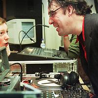 Nederland. Amsterdam. 12 maart 2002..Joost Zwagerman als DJ beantwoord aan een verzoekplaatje tijdens de Boekenbal.