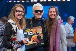 """09.06.2015, WDR Studios, Koeln, GER, TV Show, Ich stelle mich, mit Heino, im Bild Heino (Heinz Georg Kramm) mit seiner Platter """"Weit ist der weg."""" und jungen weiblichen Fans // during Germans TV Show """"Ich stelle mich"""" at the WDR Studios in Koeln, Germany on 2015/06/09. EXPA Pictures © 2015, PhotoCredit: EXPA/ Eibner-Pressefoto/ Schüler<br /> <br /> *****ATTENTION - OUT of GER*****"""