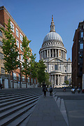 Outside St Paul's Cathedral from Sermon Lane on the 27th August 2018 in Central London in the United Kingdom. St Pauls Cathedral is an Anglican cathedral and the seat of the Bishop of London and the mother church of the Diocese of London. It located on Ludgate Hill at the highest point of the City of London and is a Grade I listed building.