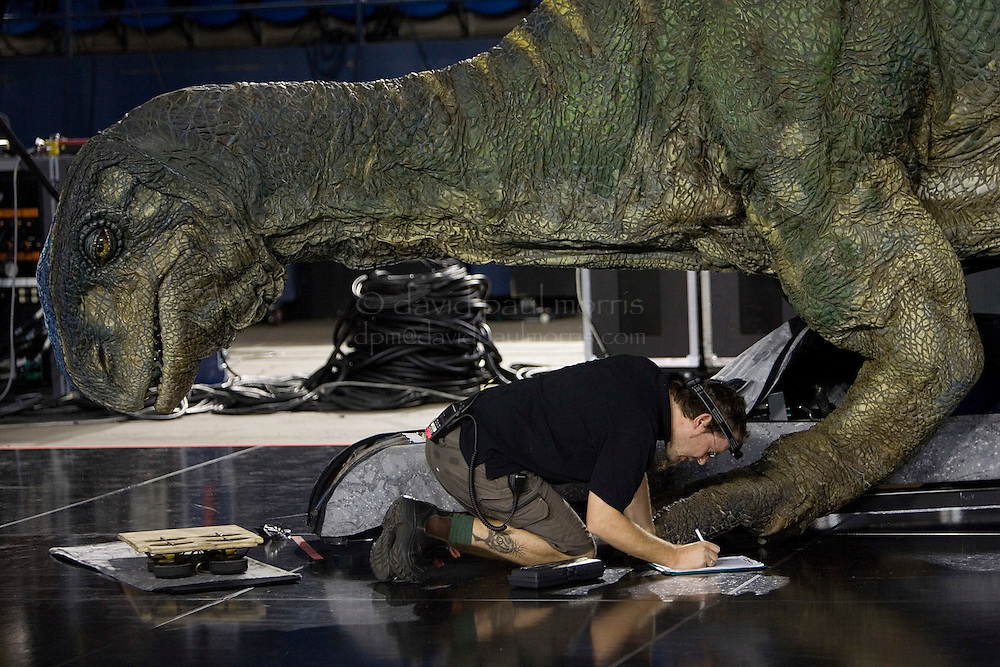 """TACOMA, WA - JULY 13:   Brett Bennett works on the Plateosaurus during a rehearsal check before a performance of """"Walking WIth Dinosaurs"""" on July 13, 2007 at the Tacoma Dome in Tacoma, Washington.  (Photo by David Paul Morris)"""
