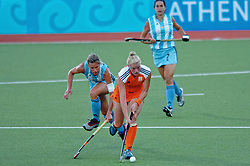 Miek van Geenhuizen of the Netherlands in action against Argentina during Olympics Games Athletics day 12 on August 24, 2004 in Olympiako Kentro Khokei, Athens.