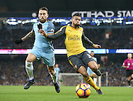 Nicolas Otamendi of Manchester City tussles with Francis Coquelin of Arsenal during the English Premier League match at the Etihad Stadium, Manchester. Picture date: December 18th, 2016. Picture credit should read: Simon Bellis/Sportimage