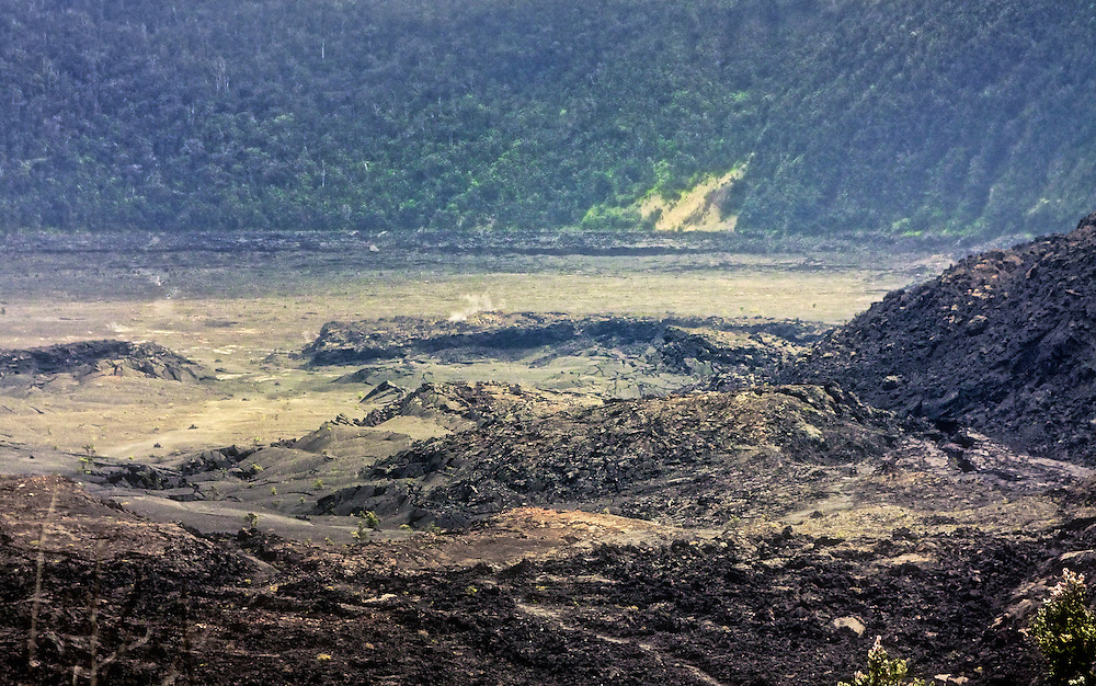 This photograph displays the vastness of a volcanic lava crater on Hawaii Island.