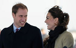 Britain's Prince William, right, is accompanied by his fiancee Kate Middleton as they visit Trearddur Bay Lifeboat Station on the island of Anglesey, Wales.