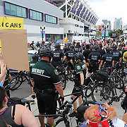 Protesters are seen during the Win With Love Rally-Together Against Trump event! in protest of visiting USA President Donald Trump and his announcement that he is campaigning for the 2020 election at the Amway Center in Orlando Florida USA 18 June 2019
