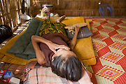 15 MARCH 2006 - CHONG KOH, KANDAL, CAMBODIA: A woman sleeps in her home in Chong Koh, a village on the Mekong River in central Cambodia. PHOTO BY JACK KURTZ