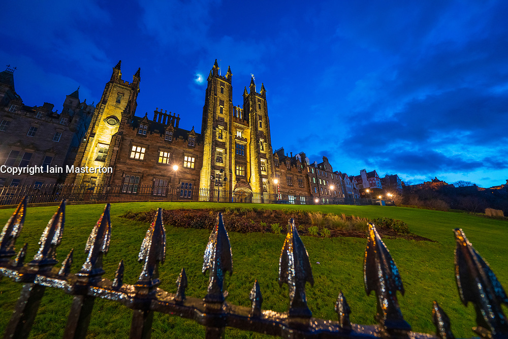 Night view of Edinburgh University New College building on The Mound in Edinburgh Old Town, Scotland, UK