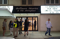 July 19, 2017 - Bellmore, New York, United States - Filmmakers, including Director BRAD KUHLMAN (at rear center of doors), and film aficionados chat outside the Bellmore Movies theater after the final night films are screened at Long Island International Film Expo LIIFE 2017. (Credit Image: © Ann Parry via ZUMA Wire)