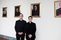 ROME, ITALY - 6 MARCH 2013: (L-R) Seminarians James Platania, 30 years old from Vernon, NJ, and James Hansen, 24 years old from Franklin Square, NY, pose for a portrait in front of portaits of the former Rectors (central portraits, from left to right, are Cardinal Edwin F. O'Brien - Rector from 1990 to 1994, and   Cardinal Timothy M. Dolan, Rector from 1994 to 2001, both of which will participate at the Conclave starting March 12th, 2013)  at the Pontifical North American College in Rome, Italy, on March 6, 2013. James Platania is attending the 4th year of studies at the Pontifical North American College, while James Hansen is attending his 2nd year...The Pontifical North American College is a Roman Catholic educational institution that forms seminarians for priestly ministry in the dioceses in the United States and that provides a residence for American priests pursuing graduate studies...Gianni Cipriano for The New York Times10139468AROME, ITALY - MARCH 10: U.S. Cardinal Timothy Dolan of New York City arrives at the Our Lady of Guadalupe church in the Monte Mario district where he is the titular head to give a Sunday Mass, in Rome, Italy, on March 10, 2013. Cardinals are set to enter the conclave to elect a successor to Pope Benedict XVI after he became the first pope in 600 years to resign from the role. The conclave is scheduled to start on March 12 inside the Sistine Chapel and will be attended by 115 cardinals as they vote to select the 266th Pope of the Catholic Church...Gianni Cipriano for The New York Times