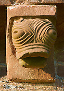 Norman Romanesque exterior corbel no 41 - sculpture of a grotesque stylised creatures head with bulging eyes. The Norman Romanesque Church of St Mary and St David, Kilpeck Herefordshire, England. Built around 1140 .<br /> <br /> Visit our MEDIEVAL PHOTO COLLECTIONS for more   photos  to download or buy as prints https://funkystock.photoshelter.com/gallery-collection/Medieval-Middle-Ages-Historic-Places-Arcaeological-Sites-Pictures-Images-of/C0000B5ZA54_WD0s