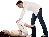 caucasian couple expecting baby pregnancy exercise isolated studio on white background