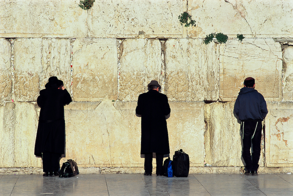 Men at the Western Wall in Jerusalem.