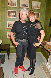 NICKY HASLAM and LYNDALL HOBBS at a party to celebrate the publication of 'A Girl From Oz' by Lyndall Hobbs held at Flat 1, 165 Cromwell Road, London on 12th May 2016.