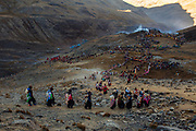 Pilgrims and dancers prepare to perform a ritual at sunrise to receive the first rays of the sun during the festivity that worships the Lord of Qoyllur Rit'i (The Lord of the Shining Snow) in Cusco, Peru.