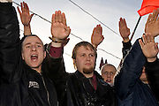 """Moscow, Russia, 04/11/2005..Russian nationalsts give fascist salutes at a demonstration in central Moscow calling for an end to the """"occupation"""" of Russia by illegal immigrants. The demonstration, organised by a variety of extremist nationalist groups led by the Eurasion Youth Union and the Movement Against Illegal Immigration, was held on the first People's Unity Day holiday, which has replaced the old holiday celebrating the Bolshevik Revolution."""