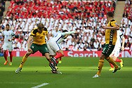 Arturas Zulpa of Lithuania fouling Dele Alli of England during the FIFA World Cup Qualifier group stage match between England and Lithuania at Wembley Stadium, London, England on 26 March 2017. Photo by Matthew Redman.