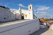 Historic whitewashed church Igreja Matrix in  medieval village of Mértola, Baixo Alentejo, Portugal, Southern Europe