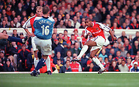 Ashley Cole shoots past Nicky Weaver for the 1st Arsenal goal. Arsenal v Manchester City, F.A.Carling Premiership, 28/10/2000. Credit Colorsport / Stuart MacFarlane.