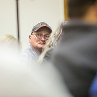 Former miner Gary Thompson listens to questions posed to Environmental Protection Agency officials at the Cibola County Complex in Grants Tuesday.