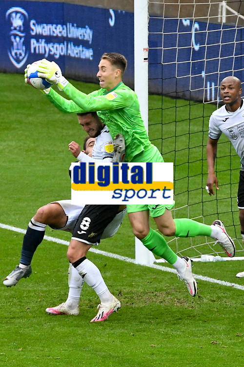 Football - 2020 / 2021 Sky Bet Championship - Swansea City vs Birmingham City - Liberty Stadium<br /> <br /> Steven Benda of Swansea City leaps to catch the ball & snuff out a Millwall attack