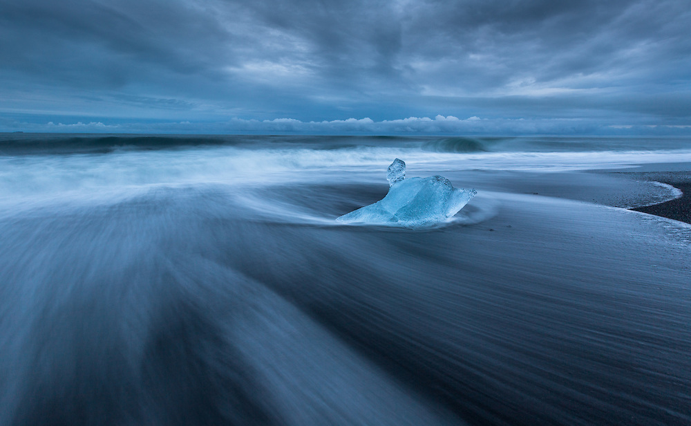 A solitary iceberg stakes its claim at the ice beach near Jökulsárlón in southeast Iceland.