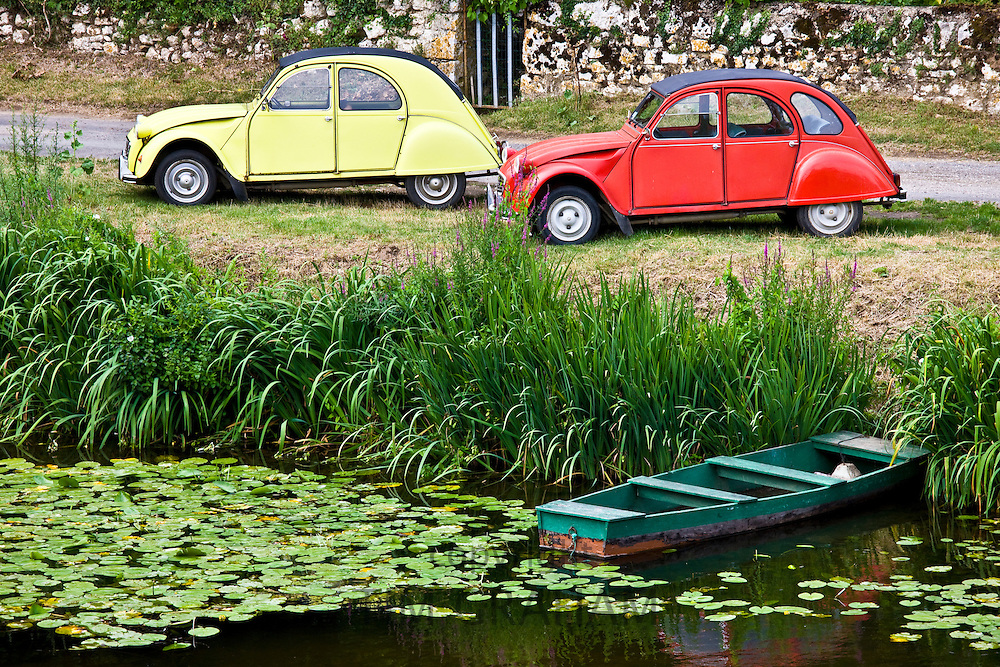 Traditional French Citroen Deux Chevaux 2CV cars at Angles Sur L'Anglin village, Vienne, near Poitiers, France