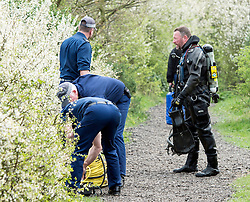 (c) Licensed to London News Pictures. 2/04/2014. Romford, UK. The Metropolitan Police close of a fishing lake at The Chase Nature Reserve in Rush Green after a human leg was found yesterday. Police divers are now carrying out a search of the lake for other parts.. Photo credit Simon Ford/LNP