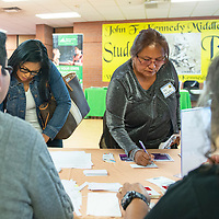 Kiana Kaibetoney, left, and Wanda Willeto, teachers at Navajo Elementary sign up for teacher library cards  Wednesday, July 31 during the Gallup McKinley County Schools new teacher orientation at John F. Kennedy Middle School in Gallup. The library card for teachers allow them to check out up to 30 items from the Octavia Fellin Public Library.