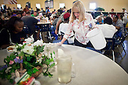 """Sept. 27 - PHOENIX, AZ: CAROL PICCO, a volunteer at the Society of St. Vincent de Paul in Phoenix, cleans tables during lunch service Monday, Sept 27. September 27, 2010 is the 350th Feast Day of Saint Vincent de Paul, also known as the """"Apostle of Charity."""" To mark the day, the Society of St. Vincent de Paul in Phoenix served birthday cake during the lunch service. The US Census office recently announced that poverty in the US has spiked to 14.3% of the population, the highest poverty rate since 1994. Officials at St. Vincent de Paul in Phoenix said that demand for their services have increased steadily in the last three years. They currently feed about 1,100 people, either homeless or members of the working poor, every day.    Photo by Jack Kurtz"""