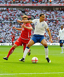 04.06.2011, Wembley Stadium, London, ENG, UEFA EURO 2012, Qualifikation, England vs Switzerland, im Bild Rio Ferdinand of England holds off Admir Mehmedi of Switzerland.England v Switzerland.Euro 2012 qualifying.Wembley Stadium. London. UK. 4/6/11. EXPA Pictures © 2011, PhotoCredit: EXPA/ IPS/ Sean Ryan +++++ ATTENTION - OUT OF ENGLAND/UK and FRANCE/FR +++++
