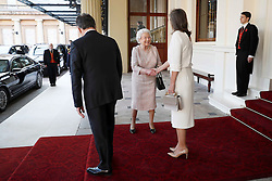 Queen Elizabeth II (centre) bids farewell to Colombia's President Juan Manuel Santos and his wife Maria Clemencia de Santos at Buckingham Palace in London.