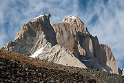 """Aguja Guillaumet (left) and Mount Fitz Roy (3405 m or 11,171 ft elevation) appear foreshortened and compressed together, as seen from Piedra Negra, above Rio Electrico Valley, in Argentina, South America. We hiked the scenic Rio Electrico Valley to Refugio Piedra del Fraile (""""Stone of the Friar"""", 14.5 km round trip) and slept overnight in a basic 4-person dorm room using our sleeping bags carried to use on their pads. Monte Fitz Roy is also known as Cerro Chaltén, Cerro Fitz Roy, or Mount Fitz Roy. The first Europeans recorded as seeing Mount Fitz Roy were the Spanish explorer Antonio de Viedma and his companions, who in 1783 reached the shores of Viedma Lake. In 1877, Argentine explorer Francisco Moreno saw the mountain and named it Fitz Roy in honour of Robert FitzRoy who, as captain of HMS Beagle, had travelled up the Santa Cruz River in 1834 and charted large parts of the Patagonian coast. Mt Fitz Roy was first climbed in 1952. Cerro is a Spanish word meaning hill, while Chaltén comes from a Tehuelche word meaning """"smoking mountain"""", due to clouds that usually form around the peak."""